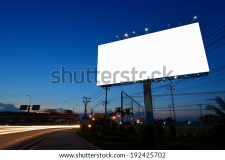 Blank billboard for advertising at twilight - stock photo