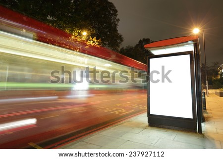 Blank billboard in bus stop at night with the lights of the cars passing by, great copy space for your design, shot in London, United Kingdom, uk - stock photo