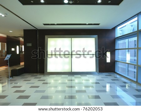 Blank billboard in modern building - stock photo