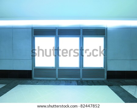 Blank billboard in modern building - stock photo