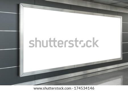 Blank billboard in modern interior hall - stock photo