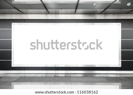 Blank billboard in modern interior hall useful for advertising - stock photo