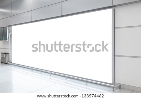 Blank billboard in modern underground hall - stock photo