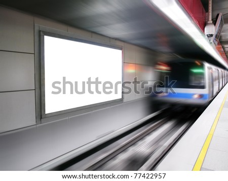 Blank billboard in subway station - stock photo