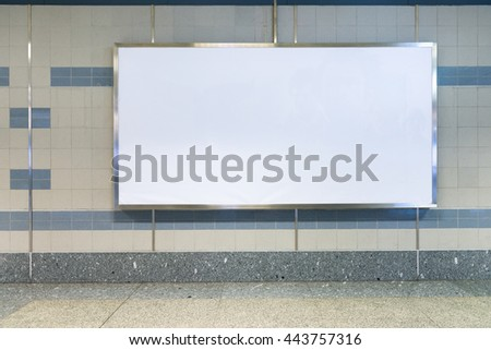 Blank billboard in subway station. Useful for your advertising. Advertising board in public area. - stock photo
