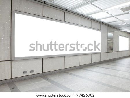 Blank billboard in the city building, shot in subway station, white empty copy space is great for user