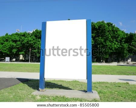 Blank billboard in the park - stock photo