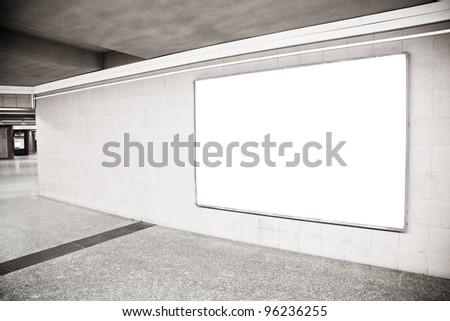 Blank billboard located in underground hall - stock photo