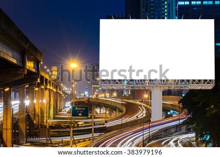 Blank billboard near expressway at night for advertisement. - stock photo