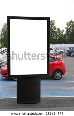 Blank billboard on a parking lot  - stock photo