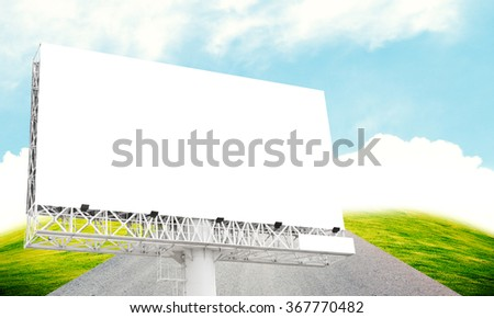 Blank billboard on blue sky with highway - stock photo