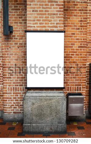 Blank billboard on brick wall - stock photo