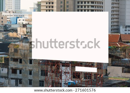 blank billboard on building business district. - stock photo