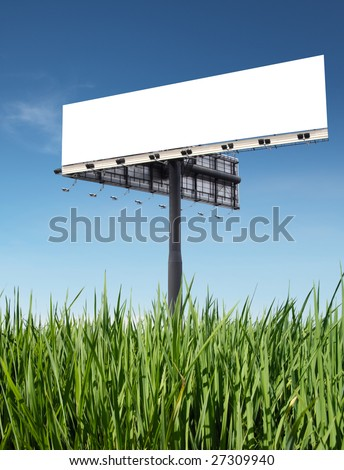 blank billboard on grass with blue sky