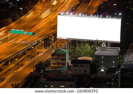 Blank billboard on the highway at twilight. - stock photo