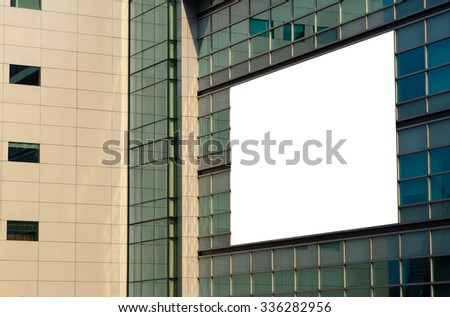 Blank billboard on the new glass wall building, perspective. - stock photo