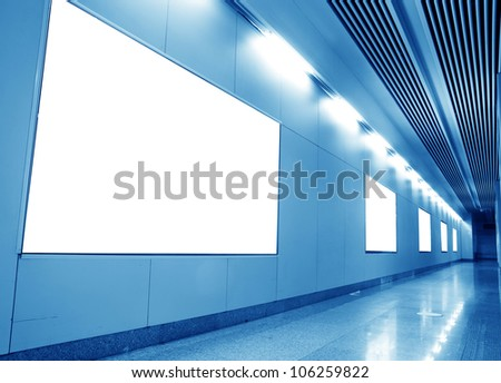 blank billboard on the wall in subway station channel - stock photo