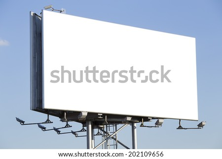 Blank billboard over a blue sky - stock photo