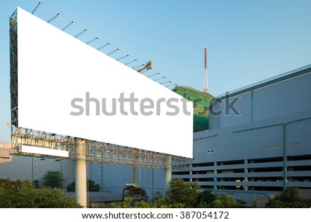 Blank billboard ready for new advertisement , City scape background - stock photo