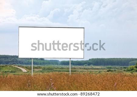 Blank billboard sign on a field - stock photo