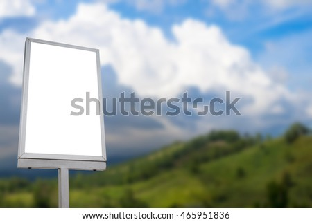 Blank billboard with blurred  on a mountain view copy space