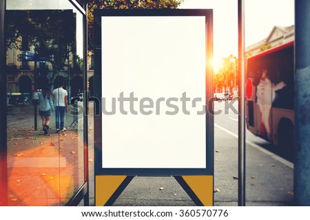Blank billboard with copy space area for your text message or promotional content, public information board in urban setting, metropolitan city bus stop with empty mock up banner for your advertising - stock photo