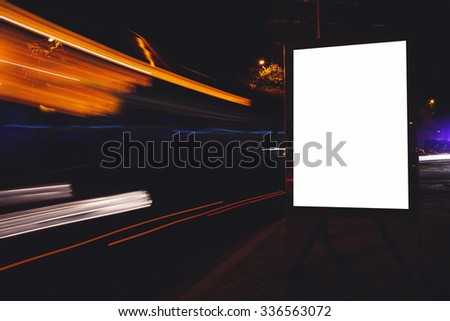 Blank billboard with copy space for your text message or content, advertising mock with movement of cars on the background, public information board in urban setting, empty poster on the street  - stock photo