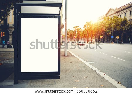 Blank billboard with copy space for your text message or content, public information board on roadside, advertising mock up empty banner in urban areas on a bus stop, clear poster outdoors  - stock photo
