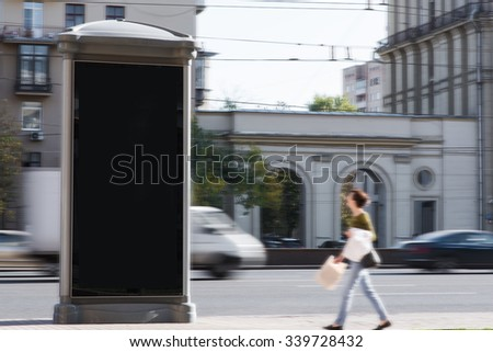 Blank billboard with copy space for your text message or promotional content, public information board in the big town, empty advertising mock up empty banner in metropolitan city in day time  - stock photo