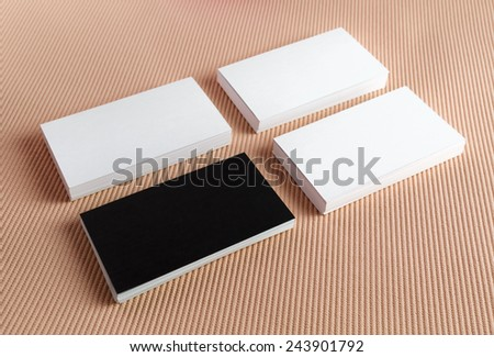 Blank black and white business cards on a color background. Template for branding identity. - stock photo