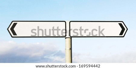 Blank black and white roadsign indicating a choice of direction  - stock photo