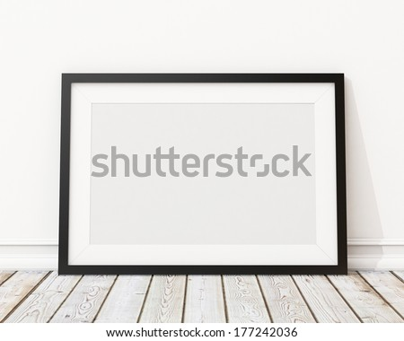 blank black horizontal picture frame on the wall and the floor  - stock photo