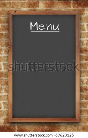 blank black menu chalkboard on brick wall