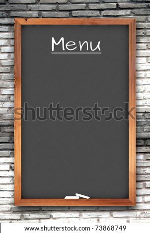 blank black menu chalkboard on white brick wall
