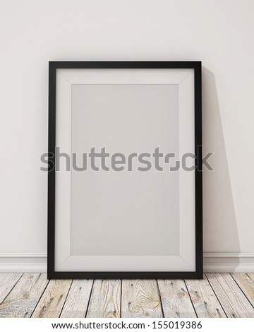 blank black picture frame on the wall and the floor - stock photo