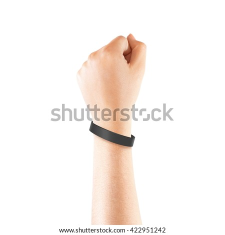 Blank black rubber wristband mockup on hand, isolated. Clear sweat band mock up design. Sport sweatband template wear on wrist arm.  Silicone fashion round social bracelet wear on hand. Unity band. - stock photo