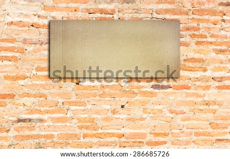 Blank black sign on brick wall