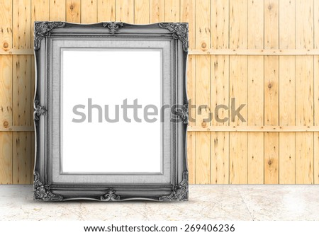 Blank black Vintage frame on marble floor and plank wooden wall,Template mock up for adding your design - stock photo
