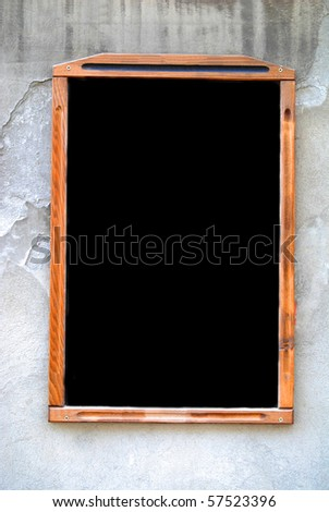 Blank blackboard menu sign on a white brick wall. - stock photo