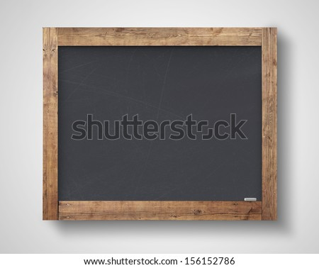 blank blackboard on a gray wall