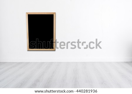 Blank blackboard on White wall with wooden gray floor and copyspace for your text, product display - stock photo