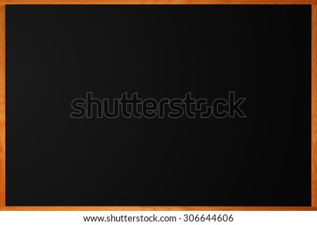 Blank blackboard with wood frame as background - stock photo