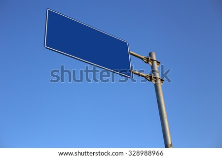 Blank Blue Road Sign with clear blue sky background.
