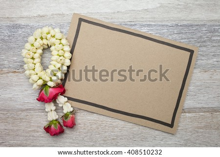 Blank board and Garland on wooden background  - stock photo