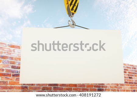 Blank board on crane hook with clear sky and brick wall in the background. Mock up, 3D Rendering - stock photo