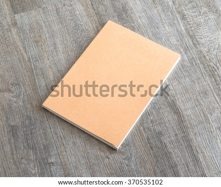 Blank book catalog magazines brochure note cover template w/ recycle brown paper texture, grey color wood table/ wooden floor background: Eco friendly empty note book page on timber backdrop for text - stock photo