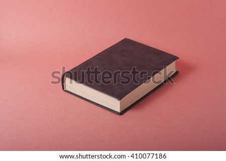 Blank book cover on textured colorful background. Copy space - stock photo