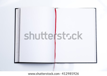 Blank book open with red ribbon and white pages - stock photo