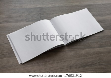 Blank. Booklet isolated on wooden textural background - stock photo