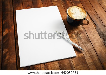 Blank branding template on vintage wooden table background. Photo of blank letterhead, coffee cup and pen. Blank stationery set. Blank mock-up for your design. - stock photo